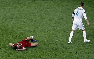 Real Madrid's Sergio Ramos, right, walks away after a collision with Liverpool's Mohamed Salah, left, during the Champions League Final soccer match between Real Madrid and Liverpool at the Olimpiyskiy Stadium in Kiev, Ukraine,  May 26, 2018. (Darko Vojinovic/AP)