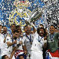 Real Madrid players celebrate with the trophy after winning the Champions League Final soccer match between Real Madrid and Liverpool at the Olimpiyskiy Stadium in Kiev, Ukraine, Saturday, May 26, 2018. (AP Photo/Matthias Schrader)