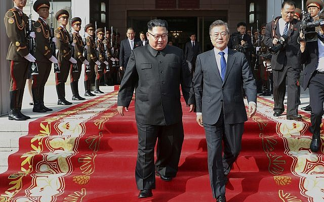 In this May 26, 2018 photo provided on May 27, 2018, by South Korea Presidential Blue House, North Korean leader Kim Jong Un, center left, and South Korean President Moon Jae-in, right, walk after their meeting at the northern side of Panmunjom in North Korea. (South Korea Presidential Blue House via AP)