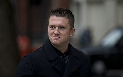 Tommy Robinson, the former leader of the far-right EDL 'English Defense League' group arrives for an appearance at Westminster Magistrates Court in London on October 16, 2013 (AP Photo/Matt Dunham).