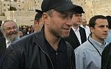Roman Abramovich, Russian oil billionaire and owner of English FA Premier League's Chelsea Football Club, walks at the Western Wall plaza in Jerusalem's Old City Tuesday Feb. 7, 2006. (AP)