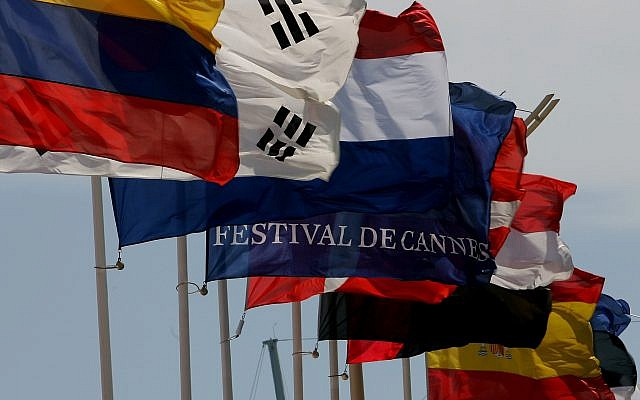 Illustrative: A Cannes Film Festival flag is seen in front of the Cannes Film Festival Palace , in Cannes, Tuesday, May 15, 2007. (AP Photo/Kirsty Wigglesworth)