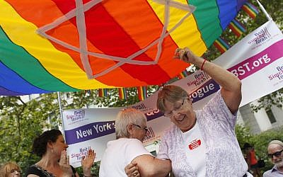 Ruthie Berman, right, and Connie Kurtz, both native New Yorkers now residing in West Palm Beach, Fla., dance outside the Manhattan City Clerk's office after getting their marriage license, Sunday, July 24, 2011 in New York. (AP Photo/Jason DeCrow)