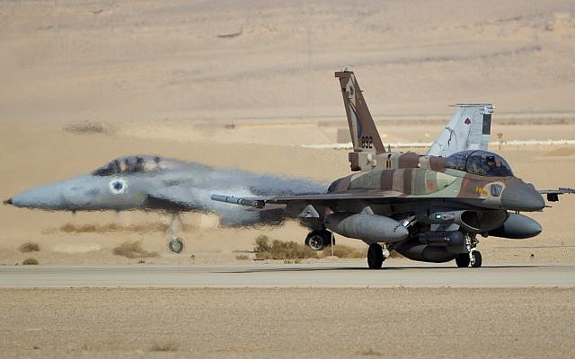 An Israeli Air Force F-16, front, and F-15, rear, prepare to take off from the Ovda airbase near Eilat, southern Israel. (AP Photo/Ariel Schalit)