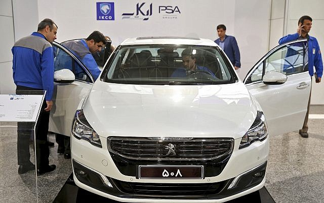 Workers inspect a Peugeot 508 at the Iran Khodro car factory in Tehran Iran Wednesday
