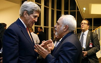 In this January 16, 2016 file photo, then-secretary of state John Kerry talks with Iranian Foreign Minister Mohammad Javad Zarif in Vienna, after the International Atomic Energy Agency (IAEA) verified that Iran has met all conditions under the nuclear deal. (Kevin Lamarque/Pool via AP, File)