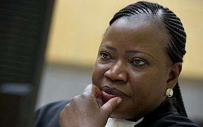 Prosecutor Fatou Bensouda waits for the start of a trial at the International Criminal Court (ICC) in The Hague, Netherlands. November 27, 2013. (Peter Dejong/AP)