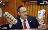 Sen. Simcha Felder, D-Brooklyn asks New York City Mayor Bill de Blasio if he knows the cost of a loaf of bread and a dozen eggs during a joint legislative budget hearing on local government on Monday, January 30, 2017, in Albany, New York. (AP Photo/Hans Pennink)