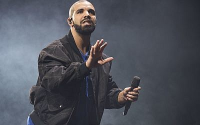 In this October 8, 2016 file photo, Drake performs onstage in Toronto. (Photo by Arthur Mola/Invision/AP, File)