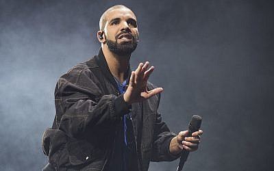 In this October 8, 2016 photo, Drake performs onstage in Toronto. (Photo by Arthur Mola/Invision/AP)