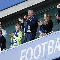 Chelsea FC owner Roman Abramovich, center, applauds at the end of the English Premier League soccer match between Chelsea and Sunderland at Stamford Bridge stadium in London, Sunday, May 21, 2017. (AP/Kirsty Wigglesworth)