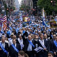 Illustrative: Honorary Grand Marshall New York Gov. Andrew Cuomo, center right, joins other dignitaries as they march along 5th Ave. during the 53rd annual Celebrate Israel Parade Sunday, June 4, 2017, in New York. (AP Photo/Craig Ruttle)