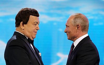 Russian President Vladimir Putin, right, congratulates popular Russian singer Iosif Kobzon before the gala to mark Kobzon's 80th birthday at the State Kremlin Palace in Moscow, Russia, September 20, 2017. (Mikhail Klimentyev, Sputnik, Kremlin Pool Photo via AP)
