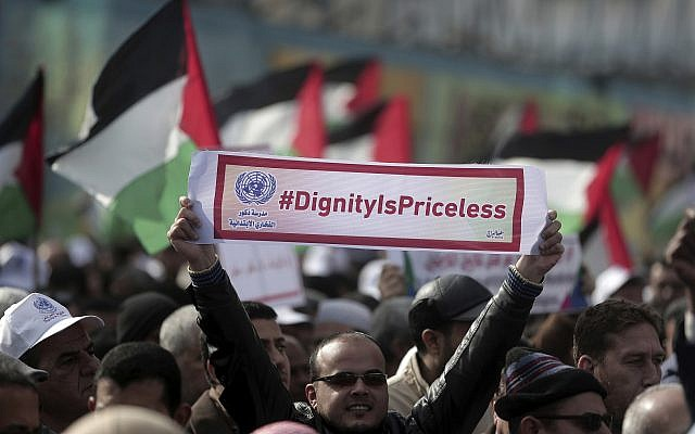 Thousands of employees of the U.N agency for Palestinian refugees demonstrate in support of their organization following US funding cuts in Gaza City, Monday, Jan. 29, 2018. (AP Photo/ Khalil Hamra)