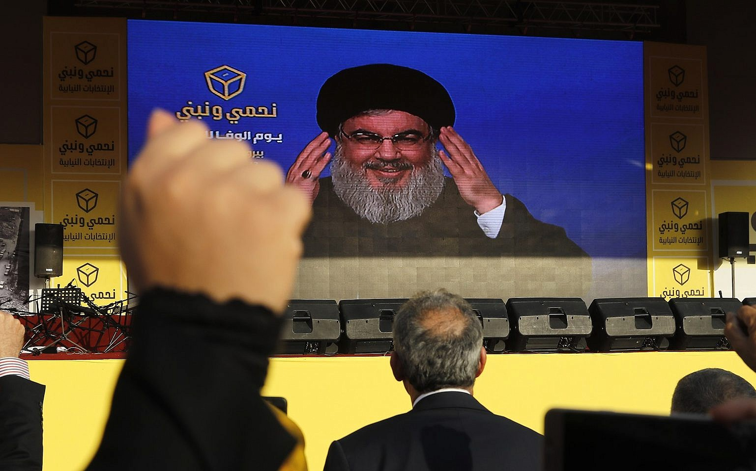 File Hezbollah leader Hassan Nasrallah delivers a broadcast speech through a giant screen during an election campaign in the southern suburb of Beirut Lebanon Friday
