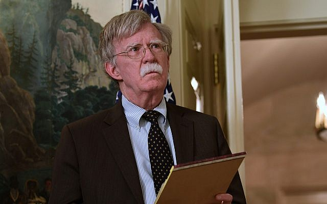 National security adviser John Bolton listens President Donald Trump speaks in the Diplomatic Reception Room of the White House on Friday, April 13, 2018, in Washington, about the United States' military response to Syria's chemical weapon attack on April 7. (AP Photo/Susan Walsh)