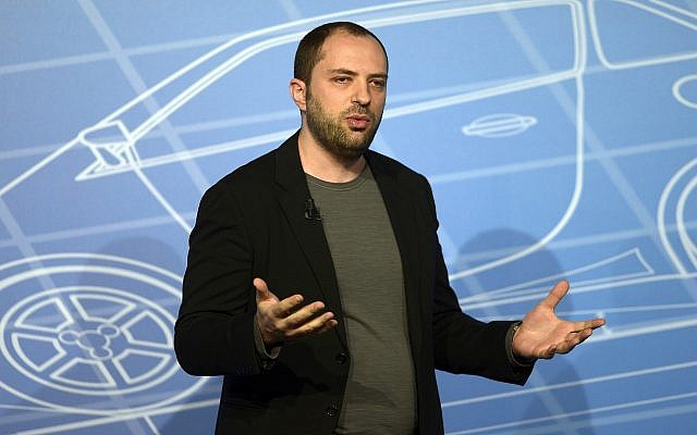 In this February 24, 2014, photo, WhatsApp co-founder and CEO Jan Koum speaks during a conference at the Mobile World Congress in Barcelona, Spain. (AP Photo/Manu Fernandez)
