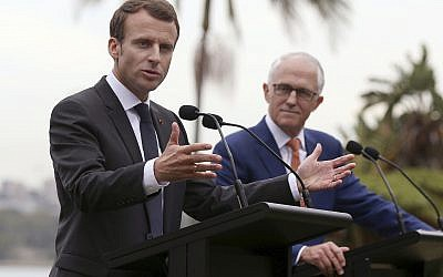 French President Emmanuel Macron, left, speaks as Australian Prime Minister Malcolm Turnbull listens during a joint press conference in Sydney, Wednesday, May 2, 2018. (AP Photo/Rick Rycroft)