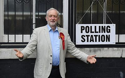 Britain's opposition Labour Party leader Jeremy Corbyn poses for photographers as he arrives to cast his vote for local council elections at a polling station in Holloway, London, Thursday May 3, 2018. (Victoria Jones/PA via AP)