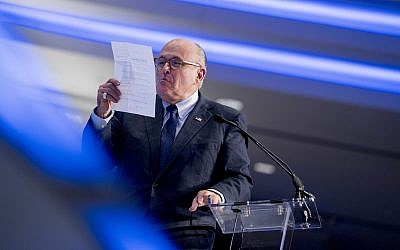 Rudy Giuliani, an attorney for President Donald Trump, pretends to spit on a piece of paper as he speaks about the Iran nuclear agreement at the Iran Freedom Convention for Human Rights and democracy, Saturday, May 5, 2018, in Washington. (AP Photo/Andrew Harnik)