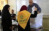 A Lebanese Hezbollah supporter casts a ballot at a polling station during the Lebanon's parliamentary elections in a southern suburb of Beirut, Lebanon, Sunday, May 6, 2018. (AP Photo/Hassan Ammar)