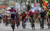 Italian cyclist Elia Viviani reacts as he crosses the finish line during the third stage of 2018 Giro d'Italia, Tour of Italy cycling race, in the Red Sea city of Eilat, on May 6, 2018. (AP Photo/Ariel Schalit)