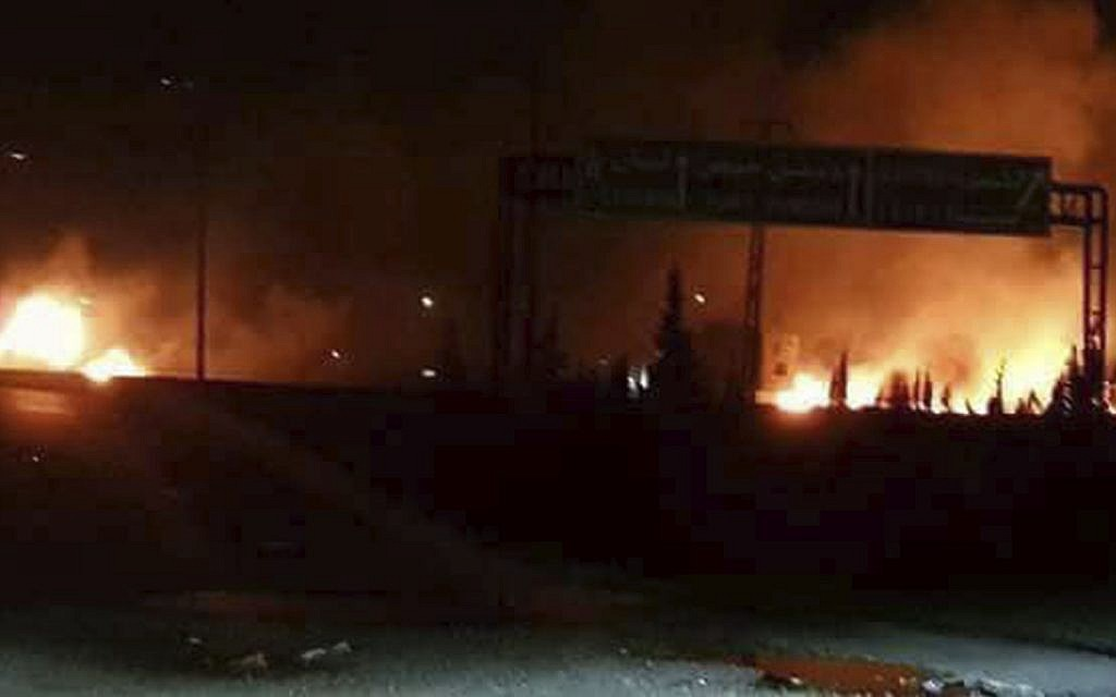 Illustrative: Flames rising after an attack in an area known to have numerous Syrian army military bases, in Kisweh, south of Damascus, released by Syria's official news agency on May 9, 2018. (SANA, via AP)