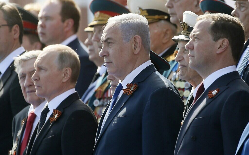 Russian President Vladimir Putin, left, Prime Minister Benjamin Netanyahu, center, and Russian Prime Minister Dmitry Medvedev, right, attend a military parade celebrating 73 years since the victory in WWII, in Red Square, Moscow, Russia, May 9, 2018. (Maxim Shipenkov/Pool Photo via AP)