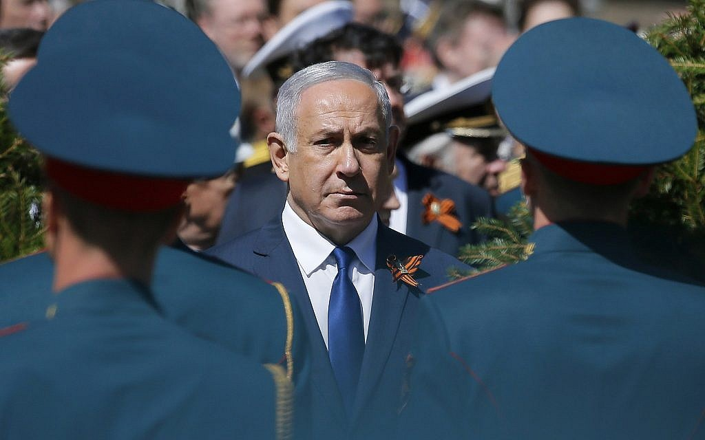 Israeli Prime Minister Benjamin Netanyahu attends a wreath-laying ceremony at the Tomb of the Unknown Soldier after the Victory Parade marking the 73th anniversary of the defeat of the Nazis in World War II, in Moscow, Russia, May 9, 2018. (AP Photo/Alexander Zemlianichenko)