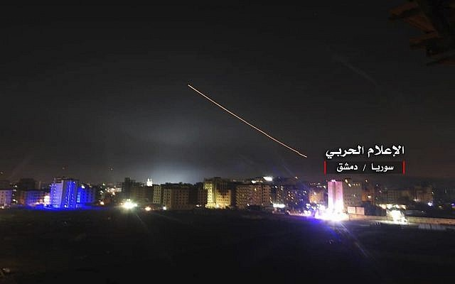 Illustrative. A photo provided by the pro-regime Syrian Central Military Media, shows anti-aircraft fire rise into the sky as Israeli missiles hit air defense positions and other military bases around Damascus, Syria, on May 10, 2018, after the Israeli military says Iranian forces launched a rocket barrage against Israeli bases on the Golan Heights, in the most serious military confrontation between the two bitter enemies to date. (Syrian Central Military Media, via AP)