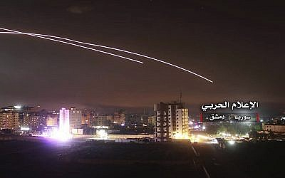 A photo provided by the pro-regime Syrian Central Military Media, shows anti-aircraft fire rise into the sky as Israeli missiles hit air defense positions and other military bases around Damascus, Syria, on May 10, 2018, after the Israeli military says Iranian forces launched a rocket barrage against Israeli bases on the Golan Heights, in the most serious military confrontation between the two bitter enemies to date. (Syrian Central Military Media, via AP)