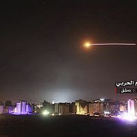 Missiles rise into the sky as Israeli missiles hit air defense position and other military bases, in Damascus, Syria, on May 10, 2018. (Government-controlled Syrian Central Military Media, via AP)