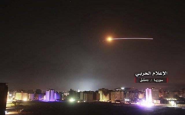 Illustrative: Anti-aircraft fire rises into the sky as Israeli missiles hit air defense positions and other military bases around Damascus, Syria, on May 10, 2018, following what the Israeli military said was an Iranian barrage of rockets against Israeli bases on the Golan Heights. (Syrian Central Military Media, via AP)