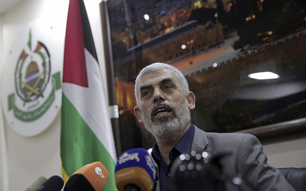 Yahya Sinwar, the Hamas leader in the Gaza Strip, speaks to foreign correspondents in his office in Gaza City on Thursday, May 10, 2018. (AP Photo/Khalil Hamra)