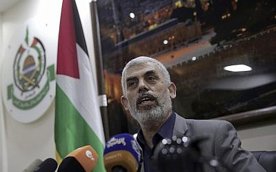 Yahya Sinwar, the Hamas leader in the Gaza Strip, speaks to foreign correspondents, in his office in Gaza City, Thursday, May 10, 2018. (AP Photo/Khalil Hamra)