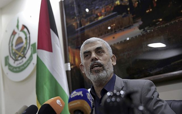 Yahya Sinwar, the Hamas leader in the Gaza Strip, speaks to foreign correspondents in his office in Gaza City, May 10, 2018. (Khalil Hamra/AP)