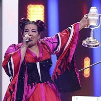 Israel's Netta Barzilai celebrates after winning the Eurovision Song Contest in Lisbon, Portugal, May 12, 2018. (AP Photo/Armando Franca)