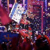 Netta Barzilai celebrates after winning the Eurovision Song Contest grand final in Lisbon, Portugal, May 12, 2018. (AP Photo/Armando Franca)