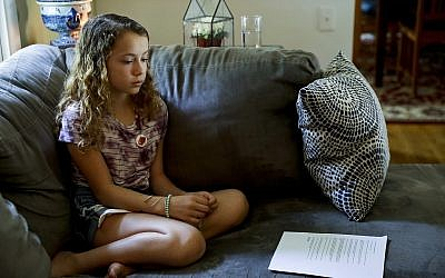 Nora Nissenbaum, 12, pauses during an interview with The Associated Press in Wayne, Pennsylvania, May 3, 2018 (AP Photo/Matt Slocum)