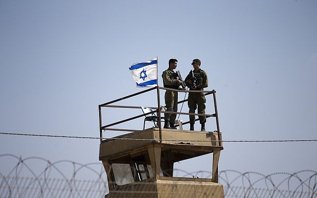 Israeli soldiers guard on top of a watch tower in a community along the Israel- Gaza Strip Border on May 15, 2018. (AP/Ariel Schalit)