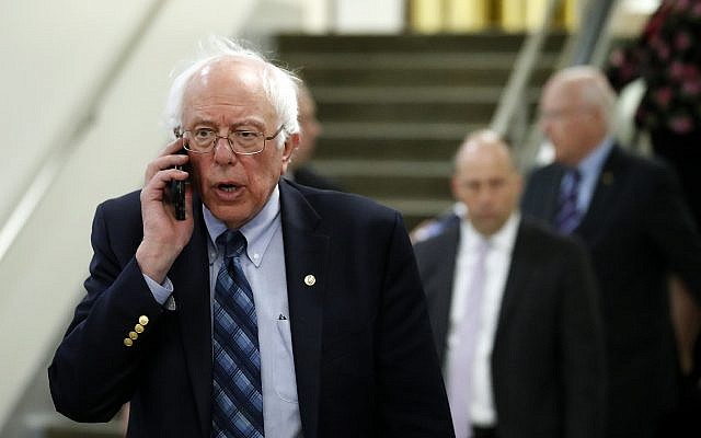 Sen. Bernie Sanders, I-Vt., talks on his phone as he departs after a vote on Gina Haspel to be CIA director, on Capitol Hill, Thursday, May 17, 2018 in Washington. (AP Photo/Alex Brandon)