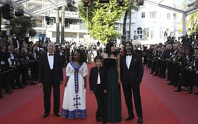 Composer Khaled Mouzanar, from right, director Nadine Labaki, actors Zain Al Rafeea, and Yordanos Shiferaw pose for photographers upon arrival at the premiere of the film 'Capharnaum' at the 71st international film festival, Cannes, southern France, Thursday, May 17, 2018. (Photo by Vianney Le Caer/Invision/AP)