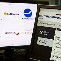 "In this May 21, 2018, photo, a computer screens display the booking website of British Airways showing ""Taiwan-China"" in Beijing, China. (AP Photo/Ng Han Guan)"