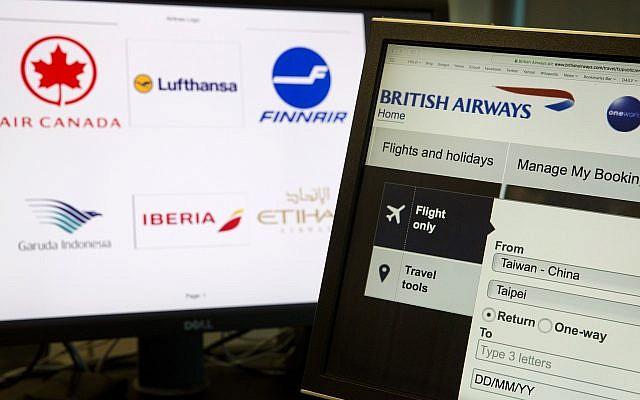 "In this May 21, 2018, photo, a computer screens display the booking website of British Airways showing ""Taiwan-China"" in Beijing, China. (AP Photo/Ng Han Guan)"