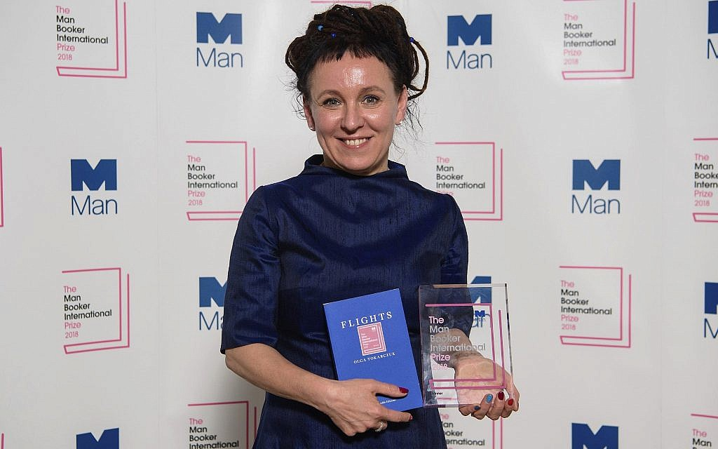Polish author Olga Tokarczuk smiles after winning the Man Booker International prize 2018, Tuesday, May 22, 2018, for her book Flights, at the Victoria and Albert Museum in London. (Matt Crossick//PA via AP)