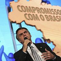 "Brazil's Presidential pre-candidate and conservative lawmaker Jair Bolsonaro, speaks during a meeting of the ""In Defense of Muncipalities"" congress, in Brasilia, Brazil, Wednesday, May 23, 2018. (AP Photo/Eraldo Peres)"