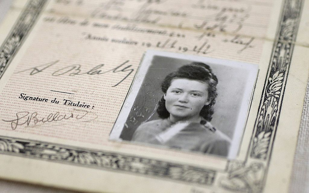 "In this Monday, May 21, 2018, photo, a World War II-era, black-and-white photograph of French student Simone Billard is attached to a fake identity card created by the French Resistance in an exhibit called ""Women in WWII: On the Home Fronts and the Battlefronts"" at The International Museum of World War II, in Natick, Massachusetts. (AP Photo/Steven Senne)"
