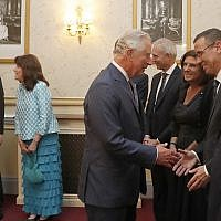 "Britain's Prince Charles shakes hands with Israel's Ambassador to the UK Mark Regev and peaks to dignitaries as he attends ""Platinum – Israel at 70,"" the Jewish community's celebration of the 70th Anniversary of the founding of the State of Israel, at the Royal Albert Hall in London, Thursday, May 24, 2018. (AP Photo/Frank Augstein, pool)"