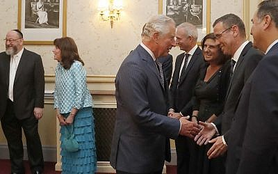 Britain's Prince Charles shakes hands with Israel's Ambassador to the UK Mark Regev and peaks to dignitaries as he attends 'Platinum – Israel at 70,' the Jewish community's celebration of the 70th Anniversary of the founding of the State of Israel, at the Royal Albert Hall in London, Thursday, May 24, 2018. (AP Photo/Frank Augstein, pool)