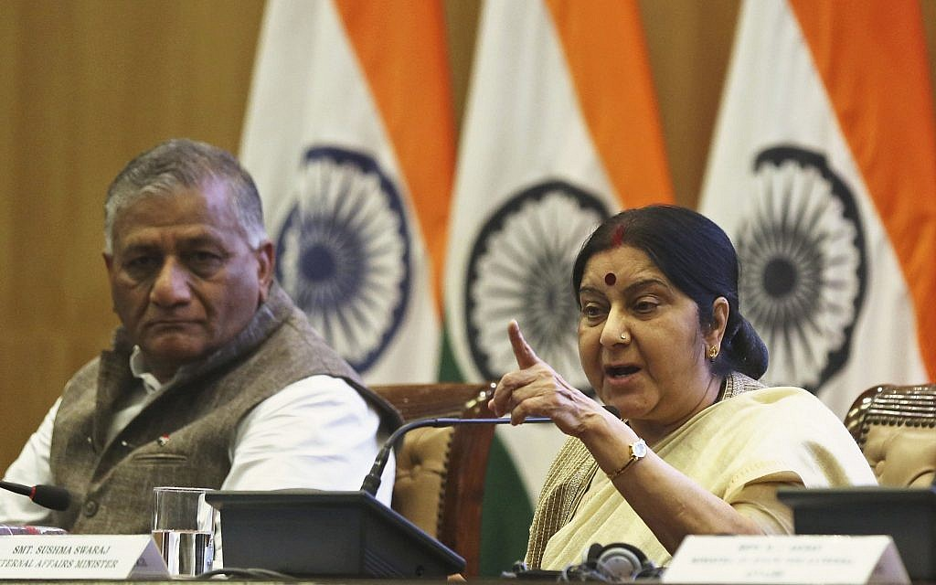 Indian Foreign Minister Sushma Swaraj addresses an annual press conference, with Junior Foreign Minister V. K. Singh seated beside her in New Delhi, India, May 28, 2018. (AP Photo)